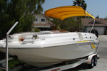 yellow bimini top on a Chaparral boat